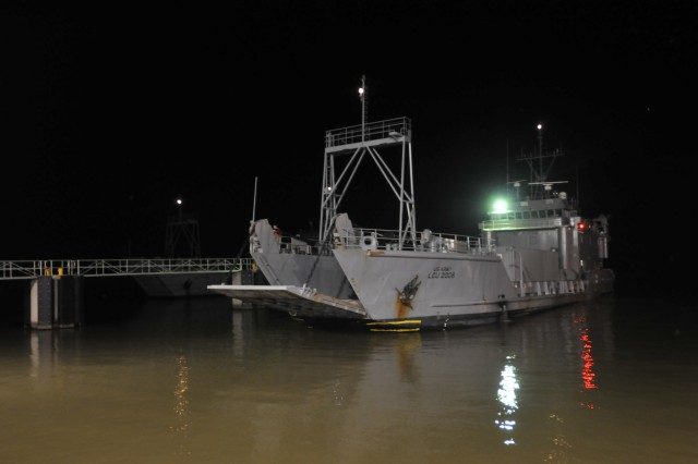 An Army Landing Craft Utility-2006 prepares to berth at Fort Eustis' 3rd Port the night of Aug. 28 upon its safe return from the Patuxent River in southern Maryland. Six Army watercraft embarked 3rd port the evening of Aug. 26 sailing for safe haven due to Hurricane Irene.