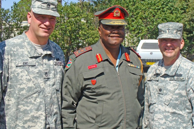 U.S. Army Africa (USARAF) Operations Chaplain Assistant Sgt. 1st Class Timothy Eye (left) and Deputy Command Chaplain (Lt. Col.) Clyde Scott with Brig. Gen. Karel C. Ndjoba, Chief of Staff for Human Resources, NDF, at the symposium's opening ceremony.