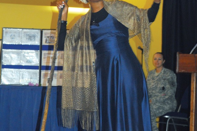 "Headquarters and Headquarters Company, U.S. Army Garrison, plays the role of Sojourner Truth as she recites ""Ain't I A Woman?"" "" a famous speech delivered to the Women's Convention in 1851 in Akron, Ohio. The recitation was part of Fort Benning's annual observance of Women's Equality Day Aug. 26 at the Benning Conference Center."