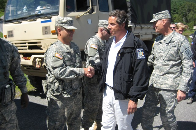 New York Governor Andrew M. Cuomo and Maj. Gen. Patrick Murphy, the Adjutant General of New York, greets members of the 719th Transportation Company from Harlem, New York City, during a damage assessment tour of the flood-ravaged Schoharie Valley in the aftermath of Hurricane Irene.