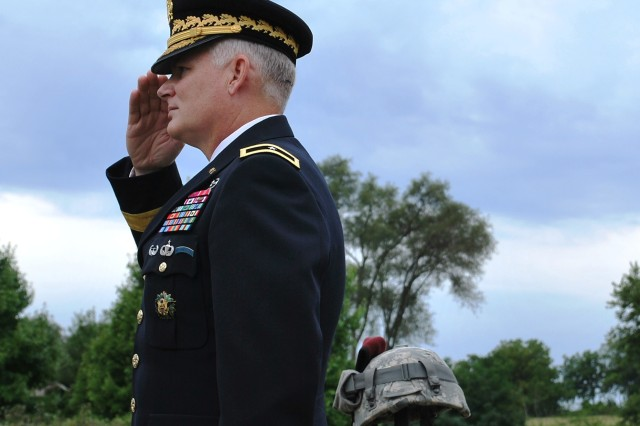 Brig. Gen. Brian Layer, ASC deputy commanding general, salutes during the closing ceremony of the Tribute to Our Fallen, held Aug. 28 at Davenport, Iowa, Memorial Park. (U.S. Army photo by Dan Carlson)