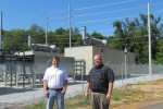 Energy Management Office Personnel For Garrison Stand In Front Of Generators
