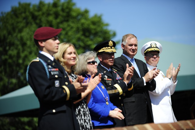 Army Gen. David H. Petraeus, Deputy Defense Secretary William J. Lynn III and Navy Adm. Mike Mullen, chairman of the Joint Chiefs of Staff, applaud during a pass and review of troops at Petraeus' Armed Forces Farewell and retirement ceremony on Joint Base Myer-Henderson Hall, Va., Aug. 31, 2011.