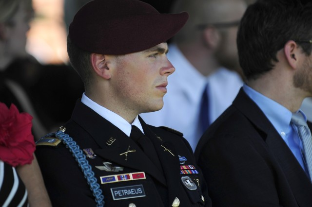 Army 1st Lt. Stephen Petraeus, son of Army Gen. David Petraeus, listens to his father's remarks during the Armed Forces Farewell and retirement ceremony to honor the general on Joint Base Myer-Henderson Hall, Va., Aug. 31, 2011.