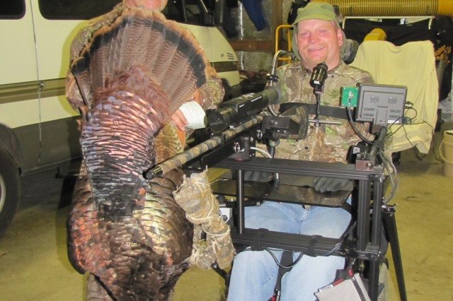 MILAN, Tenn. - (Left to Right) Dr. Tim Agee, president of the local National Wild Turkey Federation chapter, proudly displays the 20-pound turkey shot by Scott Cannedy, wounded veteran, who shot the bird on April 29, 2011, using the Liberator hunting apparatus.
