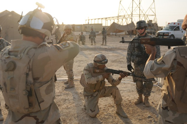 Soldiers from the 1-5 Cavalry, 2nd Brigade Combat Team, 1st Cavalry Division, train Iraqi soldier on close quarters movement during a week of marksmanship training on an Iraqi Military Post, Aug. 17, 2011. The Iraqi soldiers are learning basic marksmanship, close quarters marksmanship, advanced marksmanship and how to enter and clear a room in an urban environment.