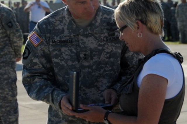 U.S. Army Maj. Gen. James McConville, the commanding general of the 101st Airborne Division (Air Assault), presents a Silver Star Medal to Roberta Pitt, mother of Spc. Jordan M. Byrd, a medic from Headquarters and Headquarters Company, 1st Battalion, 506th Infantry Regiment, 101st Airborne Division, during a ceremony Aug. 25 at Fort Campbell, Ky. Byrd was posthumously awarded the medal for his heroism and gallantry while serving as a combat medic. (U.S. Army photo by Sgt. Kimberly K. Menzies, 4th Brigade Combat Team Public Affairs)