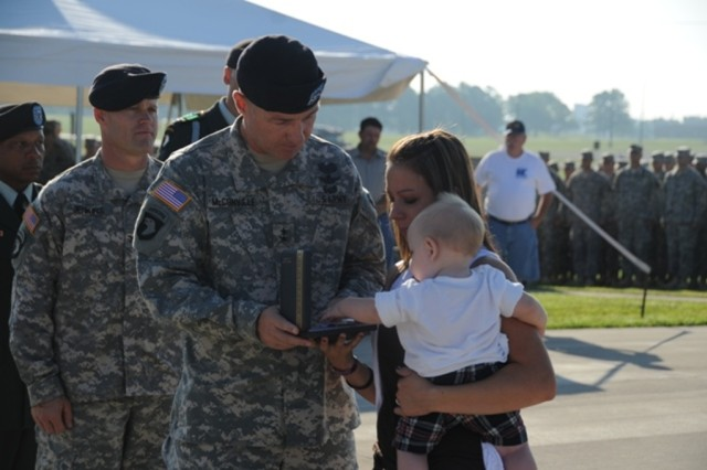 U.S. Army Maj. Gen. James McConville, the commanding general of the 101st Airborne Division (Air Assault), presents a Silver Star Medal to Savanna and Ayden Byrd, the wife and son of Spc. Jordan M. Byrd, a medic from Headquarters and Headquarters Company, 1st Battalion, 506th Infantry Regiment, 101st Airborne Division, during a ceremony Aug. 25 at Fort Campbell, Ky. Byrd was posthumously awarded the medal for his heroism and gallantry while serving as a combat medic. (U.S. Army photo by Sgt. Kimberly K. Menzies, 4th Brigade Combat Team Public Affairs)