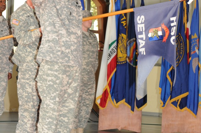 U.S. Army Africa's Headquarters Support Company conducted a change of command ceremony Aug. 31 at Caserma Ederle's Teen Center, where Maj. Brian Hanley handed over the reins of leadership to Capt. Terri Mason.