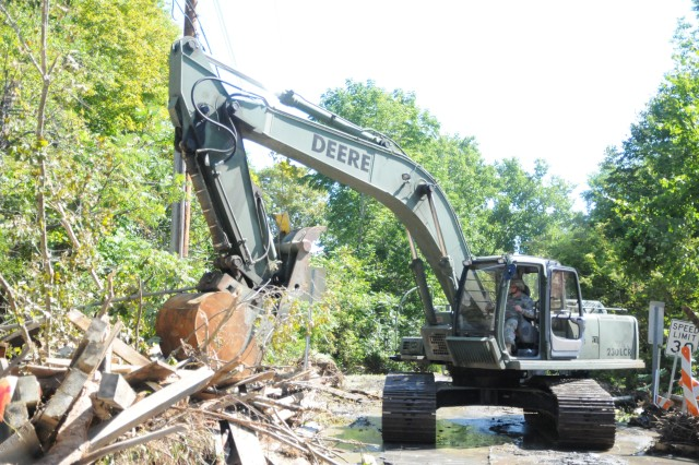 New York Army National Guard Soldiers of the 204th Engineer Battalion clear debris from Mill Valley Road in Middleburgh N.Y. following floods caused by Hurricane Irene. Soldiers are assisting authorities by clearing debris so food and supplies can be delivered to flood victims.
