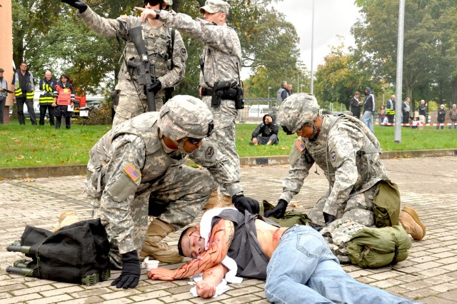 """Soldiers come to the aid of a """"victim"""" and secure the area during a force protection exercise on Wiesbaden Army Airfield, Germany."""