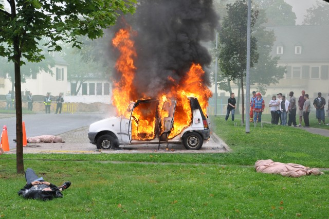 """A vehicle burns after an """"explosion"""" on Wiesbaden Army Airfield, Germany, during a force protection exercise."""