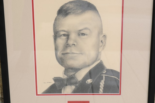 A hand-drawn portrait of Sgt. 1st Class James 'Jim' Hoffman sits on display at his widow's home in Kansas. The portrait was presented to Hoffman's widow, Vickie, after he was killed in Iraq in 2004.