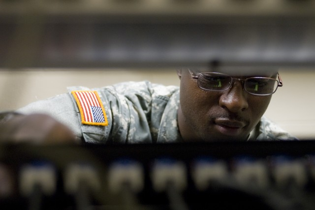 Staff Sgt. Marquis Williams, a communications noncommissioned officer with the 200th Military Police Command, works on a network switch for the command. Williams is from Decatur, Ga. The 200th MPC participated in Ulchi Freedom Guardian 2011 as part of a team of more than 530,000 service members from the Republic of Korea, United States and seven United Nations Command sending state nations that participated in the annual computer-assisted simulation command post exercise. The 200th MPC is based at Fort Meade, Md.