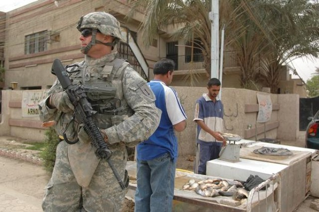 Staff Sgt. Peter Rosie, 1st Battalion, 4th Cavalry, 4th Infantry Brigade Combat Team, 1st Infantry Division, pulls security duty during his unit's deployment to Iraq in 2009. Rosie was serving as a paramedic with the New York Fire Department on Sept. 11, 2001.