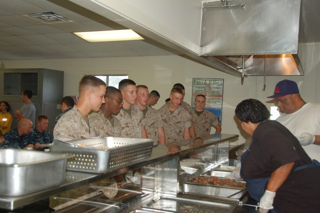 FORT A.P. HILL, Va. -- Students from Navy Training Support Center Hampton Roads line up for a warm meal prepared by Fort A.P. Hill Family and Morale, Welfare and Recreation staff at the Dining Facility Aug. 26. As the Tidewater Region braced for Hurricane Irene, students evacuated to Fort A.P. Hill.