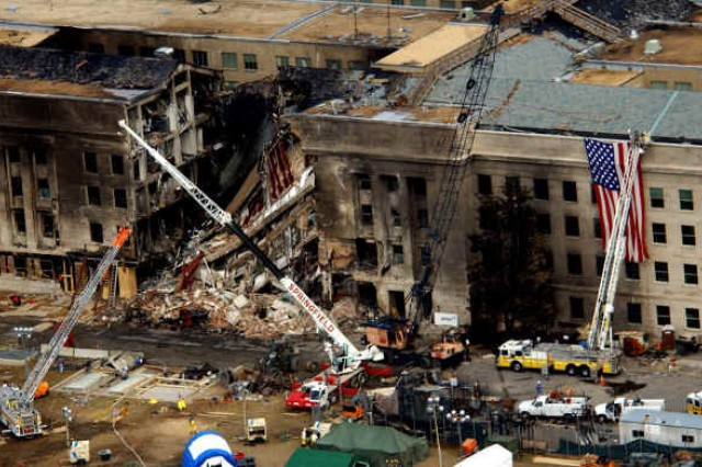 "The 26,000 military and civilians working at the Pentagon on Sept. 11, 2001 had ""no anticipation that anything would happen"" when at 9:37 a.m. Eastern time five al-Qaeda-affiliated hijackers deliberately crashed American Airlines Flight 77 into the western side of the Pentagon."
