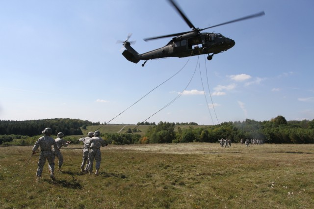 Soldiers finish their drops from a helicopter at Schweinfurt's Pfaendhausen training area. The Soldiers, who came from Schweinfurt as well as other USAREUR garrisons, utilized Schweinfurt's unique training area for a two-week Air Assault qualification course. Photo by Spc. Michael Mehrhoff, 1-77 FA
