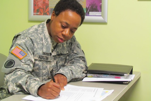 Sgt. Maj. Cynthia Austin, chief medical NCO, updates the operation order for Fox Army Health Center's Retiree Appreciation Day Health Fair, Sept. 30 to Oct. 1.
