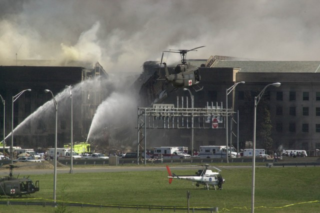 A medevac helicopter hovers near the Pentagon as first responders search for survivors and try to extinguish the fires Sept. 11, 2001.