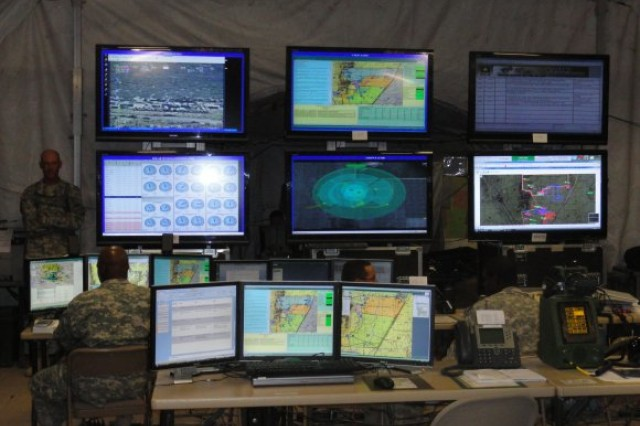 Mission command systems are shown inside a tactical operations center at White Sands Missile Range, N.M., in July. A joint experiment kicking off this month will attempt to bridge the data gap between mission command systems used by different services while automating some steps to speed communications.