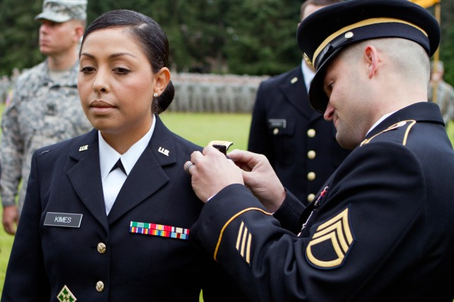 Second Lt. Perla Kimes has her bars of gold pinned on during a commissioning ceremony this summer at the Leader Development and Assessment Course on Joint Base Lewis-McChord, Wash.