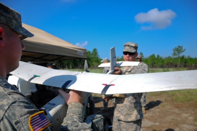 Private First Class Eric Green, 3rd Squadron, 7th Cavalry, 2nd HBCT (left) and Spc. Tyler Crawford, 1st Battalion, 30th Infantry Regiment, 2nd HBCT (right) perform pre-flight tests to the Raven UAV as part of an 80-hour training, held on Fort Stewart, to become certified Raven UAV pilots, Aug. 24.