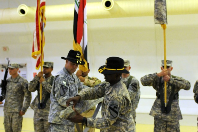 "CONTINGENCY OPERATING SITE MAREZ, Iraq "" Colonel Brian Winski (left), commander of 4th Advise and Assist Brigade, 1st Cavalry Division, and Command Sgt. Maj. Antoine Overstreet, senior enlisted advisor, case the brigade's colors during a Transfer of Authority Ceremony at Contingency Operating Site Marez, Iraq, Sept. 4, 2011. Soldiers of 4th AAB, 1st Cav. Div., transferred authority to the 4th AAB, 1st Armored Division, from Fort Bliss, Texas. ""Long Knife"" Soldiers of the 4th AAB, 1st Cav. Div., redeployed to Fort Hood, Texas, following the ceremony. (U.S. Army photo by Spc. Angel Turner, 4th AAB PAO, 1st Cav. Div., USD "" North)"