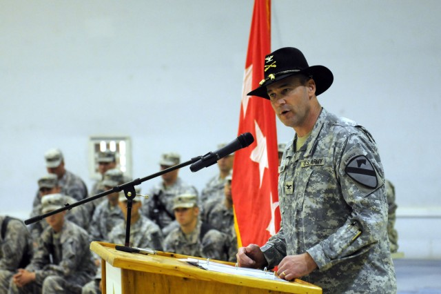"CONTINGENCY OPERATING SITE MAREZ, Iraq "" Colonel Brian Winski, commander of 4th Advise and Assist Brigade, 1st Cavalry Division, speaks to distinguished guests and fellow Soldiers during a transfer of authority ceremony at Contingency Operating Site Marez, Iraq, Sept. 4, 2011. Soldiers assigned to 4th AAB, 1st Cav. Div., transferred authority to the 4th AAB, 1st Armor Division, from Fort Bliss, Texas. (U.S. Army photo by Spc. Angel Turner, 4th AAB PAO, 1st Cav. Div., USD "" North)"