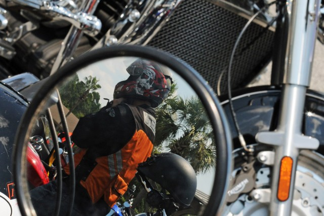 """Specialist Christopher H. Hamel, a wheeled vehicle mechanic assigned to Company D, 703rd BSTB, 4IBCT Team, Third Inf. Div., fastens his motorcycle helmet, Aug. 29, at a stop in Brunswick, Ga., during """"Vanguard Thunder,"""" a motorcycle mentorship ride sponsored by the 4-3 BSTB, 4th IBCT. Ninety-two Vanguard Soldiers participated in the safety ride."""