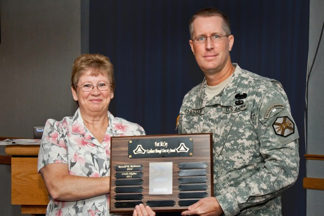 Linda Higbee (left) receives the Excellence Through Diversity Award from Fort McCoy Garrison Commander Col. David E. Chesser.