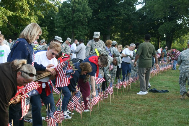 Hundreds of Soldiers and civilians placed more than 9,000 flags after participating in a 9/11 memorial walk sponsored by Army Sustainment Command at Rock Island Arsenal, Ill., Sept. 8.