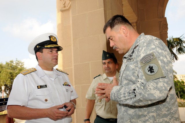Maj. Gen. Simeon G. Trombitas (right), U.S. Army South commanding general, visits with Colombian Navy Rear Adm. Cesar A. Gomez Pinillos (left), Colombian Navy chief of Naval Training and Education, and Army South foreign liaison officer Colombian Army Col. German Lopez at the Army South headquarters at Fort Sam Houston, Texas, Aug. 31, 2011.