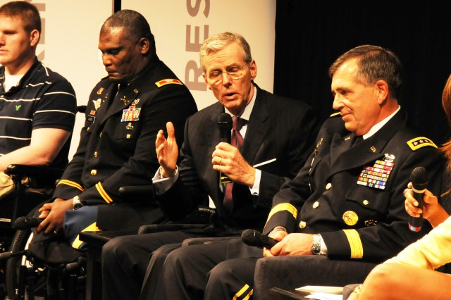 "W. Scott Gould, deputy secretary of Veterans Affairs, speaks about the relationship between the DOD and the VA during the second panel discussion following the film ""Wounded Warriors' Resilience."" From left are retired 1st Lt. Tyson Quink; Col. Greg Gadson, Army Wounded Warrior Program director; Gen. Peter Chiarelli, Army vice chief of staff, and moderator Ilia Calderon."