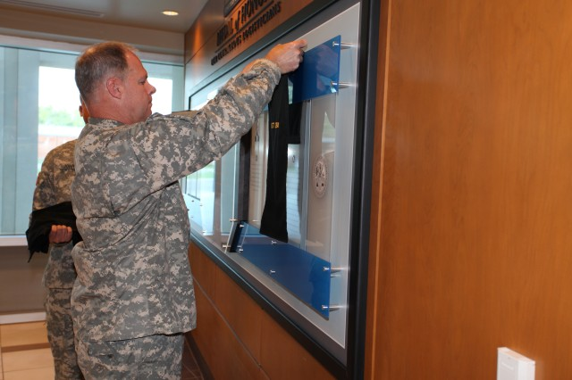 FORT LEE, Va. - Maj. Gen. James L. Hodge, Combined Arms Support Command commanding general, unveils each of the six plaques that make up the new Medal of Honor display, located inside the CASCOM headquarters, Sept. 9.