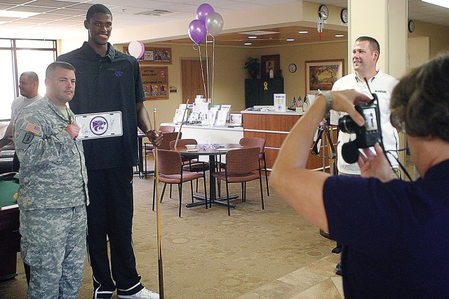 First Lt. Chris Troxell, WTB, left, poses for a photo with Jordon Henriquez, a 7-foot forward for the K-State men's basketball team, second from left, during the Wildcats' visit Aug. 30 at the SFAC at Fort Riley, Kan.