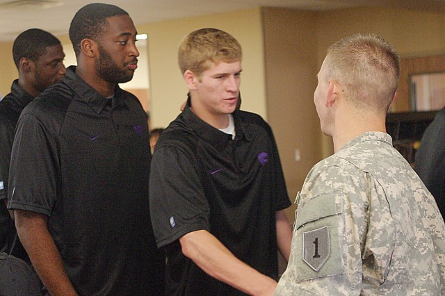 Sgt. Brett Lester, WTB, right, shakes hands with sophomore K-State guard Will Spradling during the K-State men's basketball team's visit Aug. 30 at the SFAC, Fort Riley, Kan.