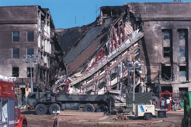 View of the west-facing wall of the Pentagon on the late afternoon of Sept. 12, 2001. Approximately 30 hours earlier, hijacked American Airlines Flight 77, a Boeing 757 with 64 passengers aboard, was purposely crashed into this spot in an act of terrorism.