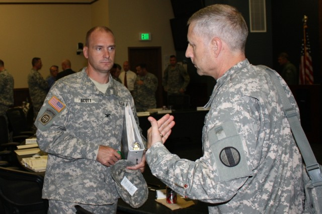 Col. Tory Scott (left), G-3/5/7 assistant chief of staff, with Brig. Gen. Peter Utley, U.S. Army Training and Doctrine Command G-3/5/7 deputy chief of staff, during the Combat Training Center Conference in Fort Leavenworth, Kan.