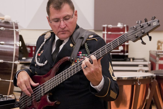 "FORT BRAGG, N.C. (Sept. 9, 2011) "" Bassist Sgt. 1st Class Daniel Rhoads will be playing with the Jazz Guardians on its ""Ohio River Valley Summer Jazz Tour"" in Kentucky and Indiana, Sept. 13-20. The ensemble is made up Soldiers who belong to The Army Ground Forces Band, which provides musical support for the Army's largest command, U.S. Army Forces Command."