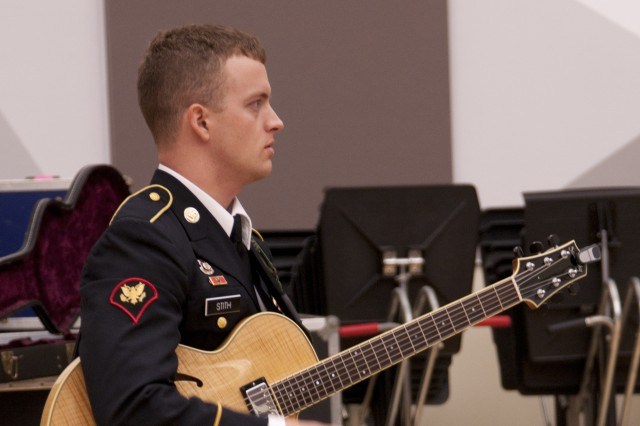 "FORT BRAGG, N.C. (Sept. 9, 2011) - Guitarist, vocalist and arranger Spc. Jacob Stith of Rineyville, Ky., will be playing with the Jazz Guardians on its ""Ohio River Valley Summer Jazz Tour"" in Kentucky and Indiana, Sept. 13-20. The ensemble is made up Soldiers who belong to The Army Ground Forces Band, which provides musical support for the Army's largest command, U.S. Army Forces Command."