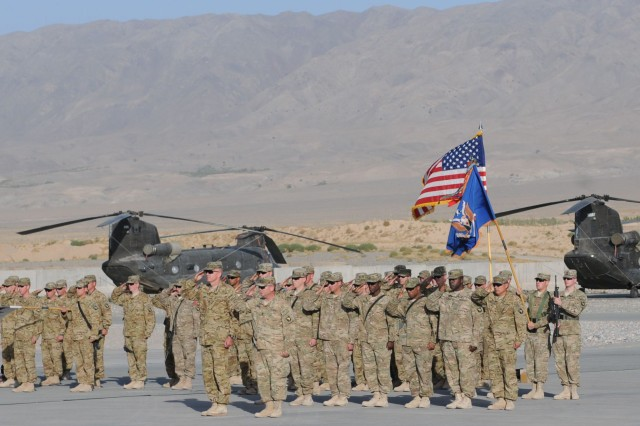 "FORWARD OPERATING BASE WOLVERINE, Afghanistan (Sept. 11, 2011) "" Soldiers of Task Force Wings (4th Battalion, 101st Aviation Regiment) render honors to those who lost their lives during and since the attacks on the World Trade Center and the Pentagon during a ceremony here Sept. 11. The ceremony commemorated the 10th anniversary of the attacks. (U.S. Army Photo by Spc. Jennifer Andersson, Task Force Thunder Public Affairs/Released)"
