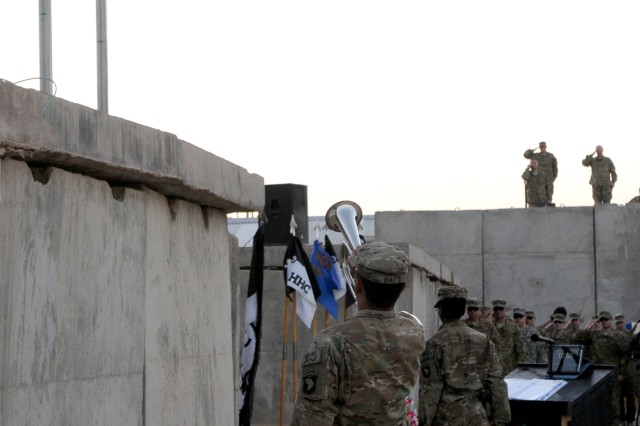 "FORWARD OPERATING BASE TARIN KOWT, Afghanistan (Sept. 11, 2011) "" Spc. Roberto Diaz, the chaplain assistant for Task Force Attack (3rd Battalion, 101st Aviation Regiment),  plays Taps on an electronic bugle at a 9/11 memorial ceremony here to honor those who lost their lives during the attacks on the World Trade Center and the Pentagon Sept. 11, 2001. This ceremony marks the 10th anniversary and was one of many held in honor of the victims of the 9/11 attacks. (U.S. Army Photo by Sgt. Shanika L. Futrell, Task Force Thunder Public Affairs/Released)"