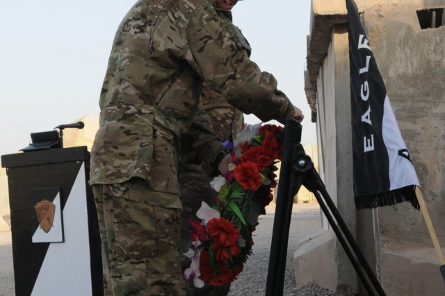 "FORWARD OPERATING BASE TARIN KOWT, Afghanistan (Sept. 11, 2011) "" Lt. Col. Roderick Hynes (foreground), the battalion commander for Task Force Attack (3rd Battalion, 101st Aviation Regiment) and his acting command sergeant major, 1st Sgt. James E. Henson, hang a wreath at a 9/11 memorial here to honor those who lost their lives during the attacks on the World Trade Center and the Pentagon Sept. 11, 2001. This ceremony marks the 10th anniversary and was one of many held in tribute to the victims of the 9/11 attacks. (U.S. Army Photo by Sgt. Shanika L. Futrell, Task Force Thunder Public Affairs/Released)"