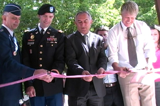"NERKIN SASNASHEN, Armenia "" From left, Maj. Gen. Mark Zamzow, 3rd Air Force vice commander, Col. D. Peter Helmlinger, U.S. Army Corps of Engineers Europe District commander, Aragatsotn province Governor Sargis Sahakyan, and a representative from World Vision cut the ribbon during a ceremony here Sept. 2, 2011, to officially open the doors of a newly-renovated kindergarten. The $425,000 renovation project, funded by the U.S. European Command and managed by the USACE Europe District in collaboration with the U.S. Embassy Office of Defense Cooperation, provided a complete overhaul to facility."