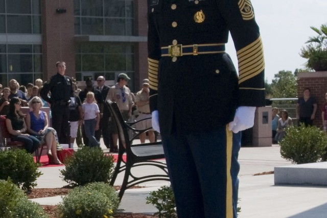 Retired Command Sgt. Maj. Marty Wells gives the command to the first responder honor guard to post during the remembrance ceremony here September 11, 2011. Wells is also the 81st Regional Support Commands Strategic Outreach Coordinator. He played a very important part in making the first responders' remembrance memorial ceremony a memorable one.