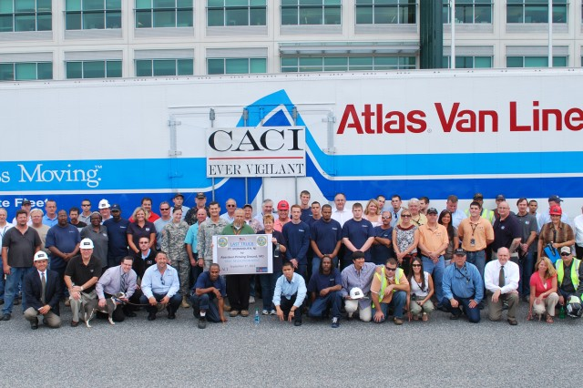 The contractor team and members of the U.S. Army Communications-Electronics Command Logistics staff celebrate the arrival of the 809th truck to leave Fort Monmouth and arrive to Aberdeen Proving Ground, Md., Sept. 1, 2011, signifying the completion of the Base Realignment and Closure move from New Jersey to Maryland.