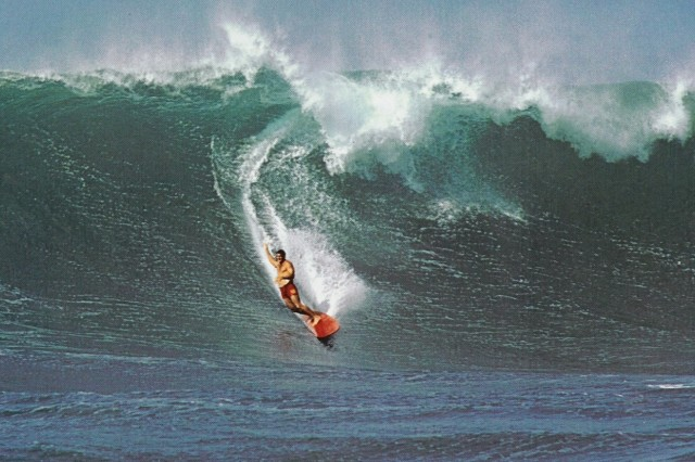 In this historical photo, Fred Hemmings, champion surfer, rides the waves at Waimea, on the island of Oahu in Hawaii.