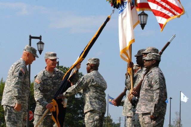 Gen. David M. Rodriguez, Forces Command incoming commanding general, returns the command's colors to Command Sgt. Maj. Roger Howard, FORSCOM acting command sergeant major, following Rodriguez' assumption of command, Sept. 12, 2011, at Fort Bragg, N.C. U.S. Army Chief of Staff Gen. Raymond T. Odierno looks on.