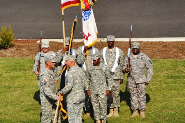 (L) Gen. David M. Rodriguez accepts the U.S. Army Forces Command colors from Gen. Raymond T. Odierno, during a Sept. 12, 2011, Assumption of Command ceremony at Fort Bragg, N.C., as Command Sgt. Maj. Roger Howard, FORSCOM's acting command sergeant major, looks on.